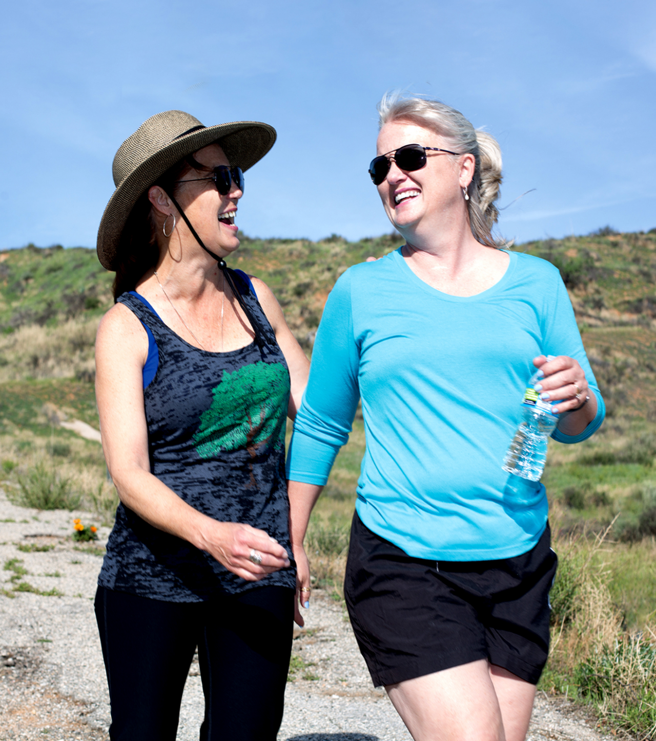 Two women hiking and talking.