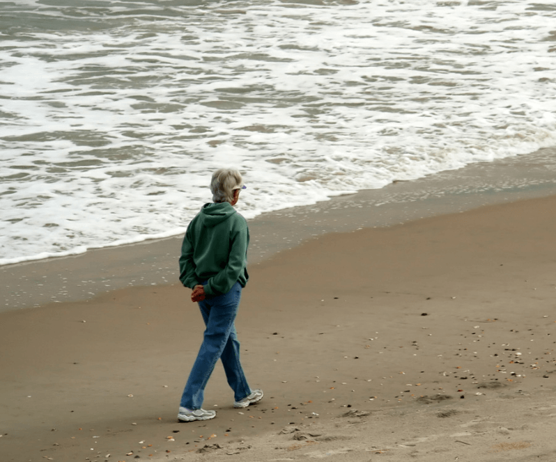 Spinal Cord Stimulation patient Mariette walking on the beach.